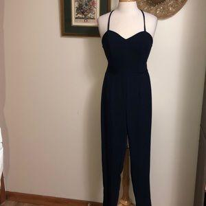 Navy Blue strappy back jumpsuit. NWOT